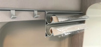 Foil holder for the kitchen rail system